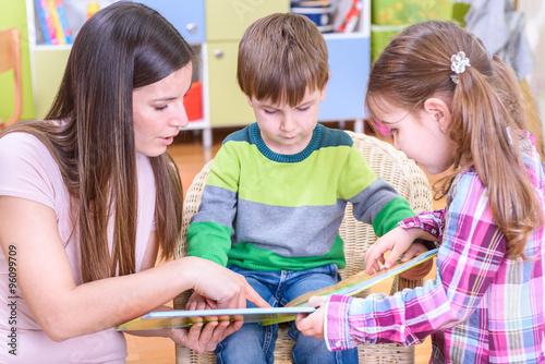 Preschool Teacher Reading To Kids