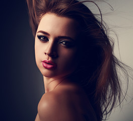Expressive sensual makeup woman with pink lipstick and smokey ey