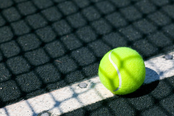 tennis court with ball and net shadow