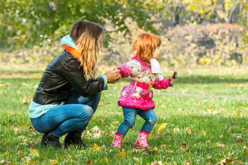 Mom plays with her daughter in the park