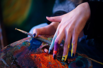 Brush in a painter's hand