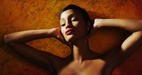 Portrait of a beautiful black model posing in front of mural