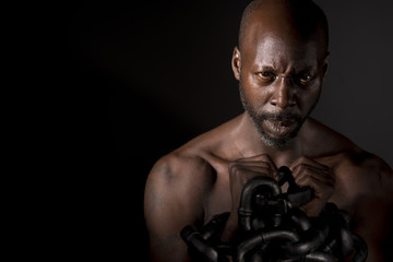 Bare Chested Black Man In Chains
