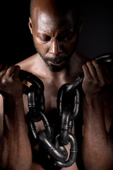 Black Man Holding Heavy Chain