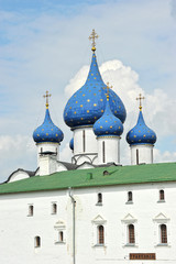 the cross and couple at the Cathedral of the Kremlin in Suzdal,