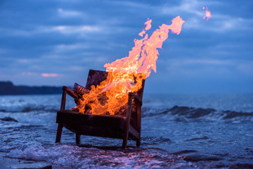 Burning old armchair