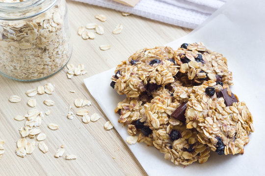 Homemade healthy oatmeal cookies on a wooden kitchen table.