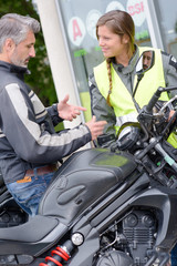 Motorcycle instructor and student having discussion before lesson
