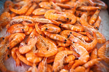 Top view of raw whole tiger prawns on ice