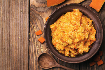 Porridge with pumpkin and millet with space for text, top view