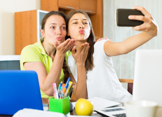 Girls making photo on mobile phone