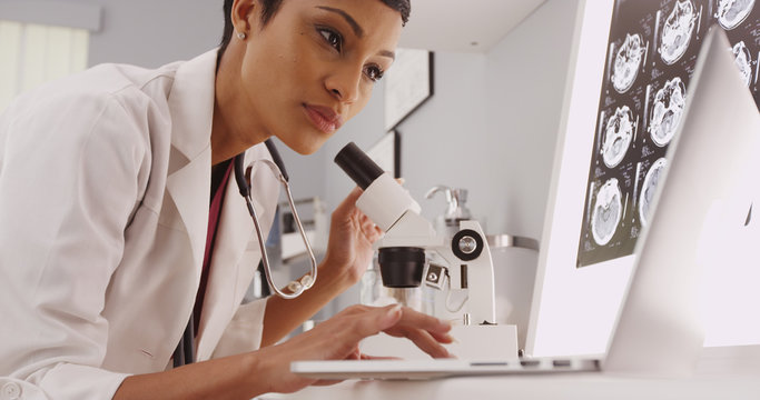 Female technician looking in a microscope