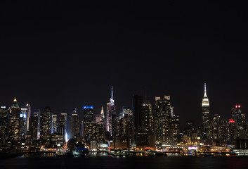 Manhattan Skyline over Hudson River at night