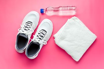 sport concept. bottle, shoes and towel