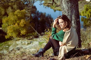 Female In Green Pullover Sitting Under The Tree