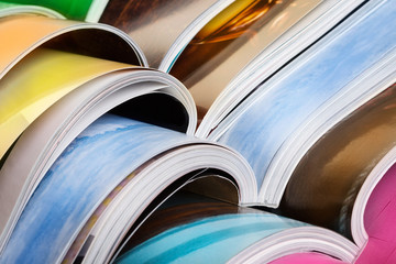 Close-up of stack of colorful magazines