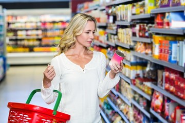 Woman reading nutritional values