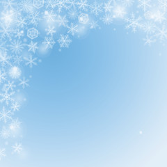 Abstract Christmas light  blue background with snowflakes.