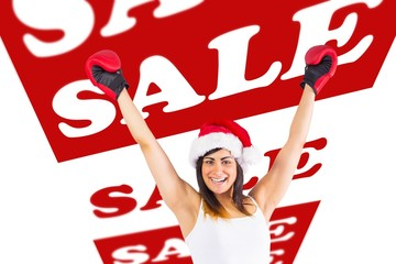 Composite image of festive brunette in boxing gloves cheering