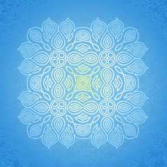White ornament on blue scroll background.