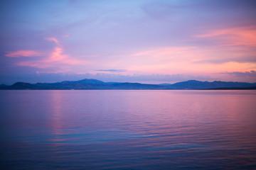 calm evening sunset scene at the water at Golfo Aranci, Sardinia, Italy