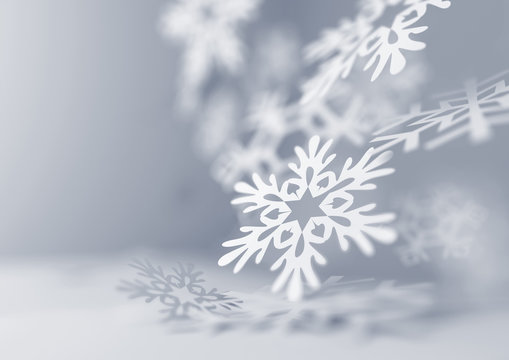 Soft Falling Snowflakes. Paper craft snowflakes close up illustration of falling snowflakes. Christmas winter background.