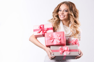 Beautiful smiling woman holding gift boxes.