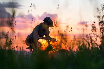 Woman mountain biking at sunset