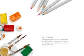 Set of color pencils used watercolor boxes, tubes and paint brushes. Top view. Isolated image with space for your text