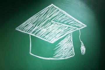 Bachelor hat drawing on blackboard background
