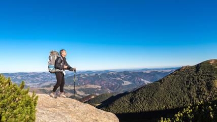 alone man on peak in carpathian mountains