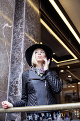 young pretty blond woman in stylish hat, street fashion