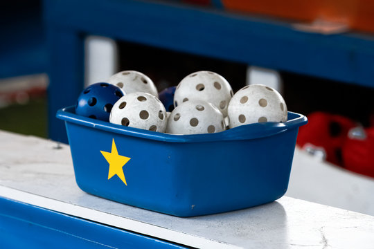 Wiffle balls in a container