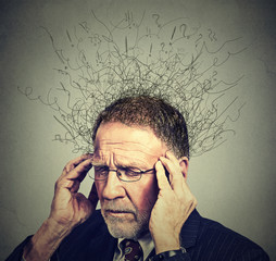senior elderly man with worried stressed face expression looking down