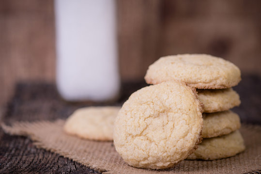 Sugar Cookies with milk jar in the background.