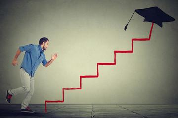 Concept of education target progress. Man student running up education ladder
