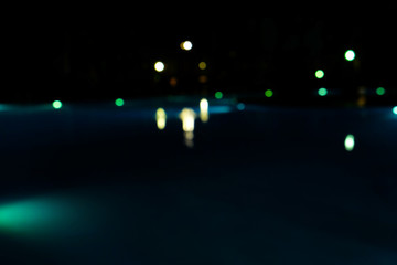 Blurred background of the swimming pool at night