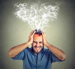 stressed man screaming thinking too hard steam coming out up of head
