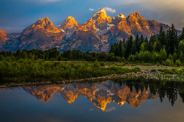 Poster Reflection The dramatic colors of the Grand Teton Mountains reflecting in the water on a clear summer morning.
