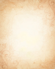 old vintage paper, abstract light brown background, beige center and aged faint flower design on border with flourishes scroll work curls and curved design elements, distressed aged paper