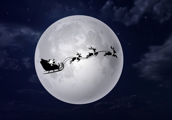 santa claus sleigh with moon and sky