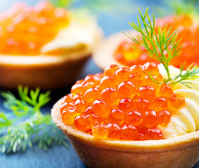 Tartlet with red caviar close up. Gourmet food, appetizer