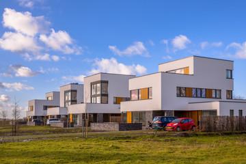 Futuristic family houses in a suburban street