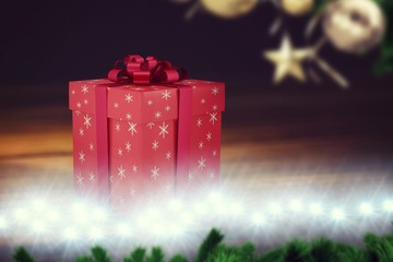 A red Christmas gift with ribbon