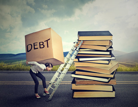 Student loan debt concept. Woman with heavy box debt carrying it up education ladder
