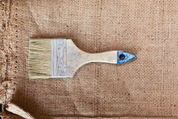 A paintbrush on sacking