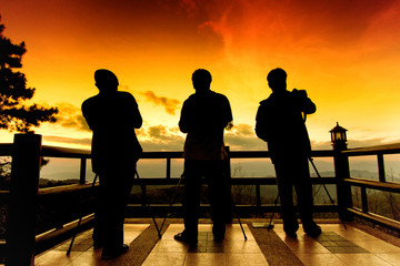 Silhouette of photographers in evening.