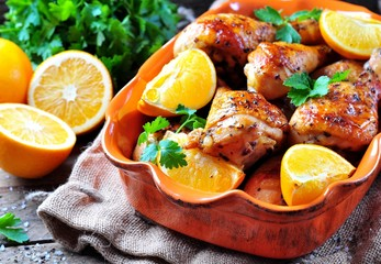 Baked chicken drumstick with orange, smoked paprika, Provencal herbs and olive oil.