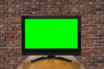 Modern Television with Chroma Key Green Screen and Red Brick Wall