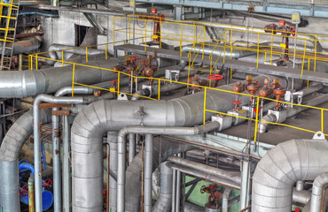 Machine room in thermal power plant with electric generators and turbines